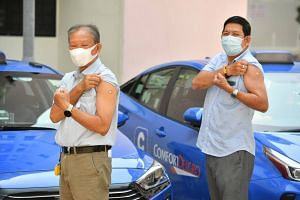 Taxi drivers Tham Yuet Kok and Tan Eng Chuan after receiving the vaccination on Feb 23, 2021