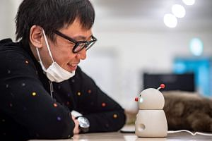 """The upcoming home assistant """"Bocco emo"""" looks like a miniature snowman and allows families to leave and send voice messages through their phones."""