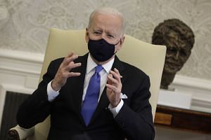 US President Joe Biden holds a bipartisan meeting on cancer at the White House in Washington.
