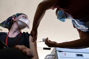 A health worker administers a coronavirus vaccine at a hospital in Soweto in February 2021.