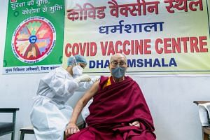 "The Dalai Lama hoped his example (above) would inspire more people to ""have courage"" to get themselves vaccinated."