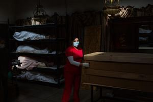 Manager and apprentice embalmer Brianna Hernandez in the chapel lobby of the Continental Funeral Home in East Los Angeles.