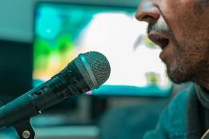 At least 215 people have recently tested positive in cases linked to daytime karaoke sessions.