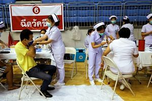People receiving the Sinovac vaccine as Phuket rushes to vaccinate its population ahead of a July 1 ending of strict quarantine for overseas visitors, on April 1, 2021.