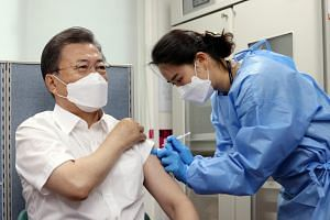 South Korean President Moon Jae-in receives a dose of the AstraZeneca Covid-19 vaccine in Seoul, on March 23, 2021.