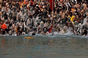 Hindu devotees gather to take a holy dip in the Ganges river in Haridwar, India, on April 14, 2021.
