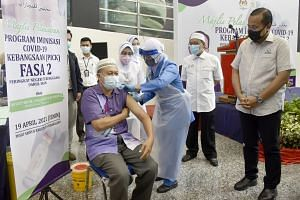A man receiving his vaccination shot at the Science and Creativity Centre in Kuala Terengganu on April 19, 2021.