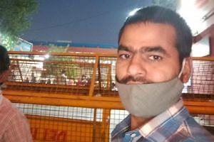 Migrant worker Athar Niyazi at a railway station in New Delhi.