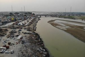 A photo from May 5, 2021, shows funeral pyres of Covid-19 victims at a cremation ground along the banks of the Ganges River.
