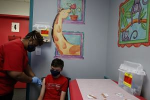 A boy is inoculated with the Pfizer Covid-19 vaccine in Decatur, Georgia, on May 11, 2021.