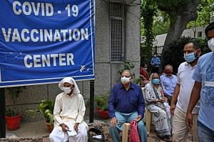 People wait to get themselves inoculated with the Covid-19 vaccine in New Delhi, on May 13, 2021.