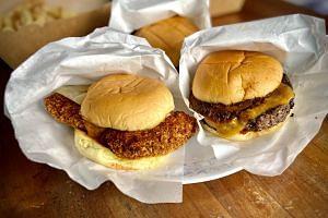 Crispy Berempah Chicken (left) and basic smoked hamburger from Dream Shop.