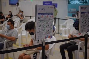 People waiting in the observation area at the Covid-19 vaccination centre at Yew Tee Community Club last week, after receiving their jabs. Slightly more than one-third of the population in Singapore have been given at least one dose of a Covid-19 vac