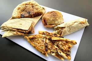 Sesame Bread, Mixed Kebab Tombik, Chicken Kebab Roll and Mixed Vegetarian Pide from Donergy Turkish Kebab.