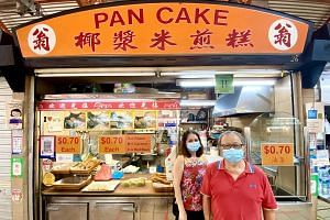Madam Loh Giat Tin and her husband Ong Kheng Kiat, who run the 27-year-old Weng Pancake stall at Maxwell Food Centre.