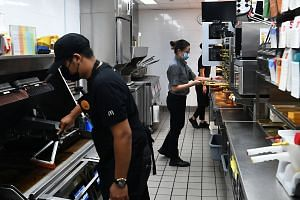Kitchen staff at the McDonald's outlet in Canberra Plaza stay within their own work station and do not move around.