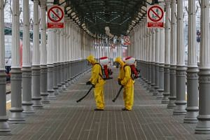 Russian Emergency Situations Ministry workers sanitising Belorussky railway station in Moscow on June 11, 2020.