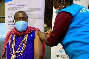 Kenyan tour guide, Daniel Ole Kissipan, receives a shot of the  AstraZeneca/Oxford Covid-19 vaccine under the Covax scheme.