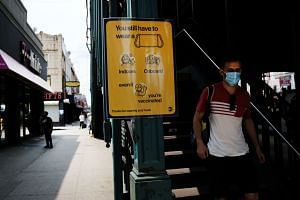A sign asks subway riders to wear a mask in  New York City, on July 22, 2021.