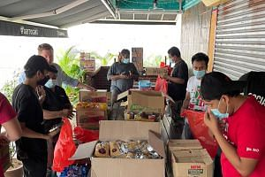 Bar Roca staff and volunteers sorting out essentials and groceries for needy families amid Malaysia's lockdown.