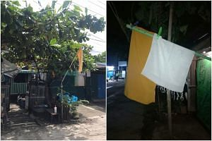 A yellow flag hung outside a home in Hlaing Tharyar township, Yangon.