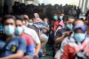 Authorities attributed the decline in cases to emergency restrictions imposed on Java and other areas of the country since early this month.