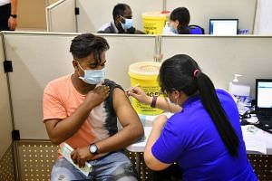 On June 8, the Ministry of Manpower said about a fifth of migrant workers living in dormitories had been fully vaccinated as at May 31.