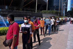 People queuing outside the Kuala Lumpur Convention Centre vaccination centre on July 28, 2021.
