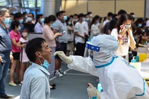 The city of Jiangsu has tested all 9.2 million residents twice as officials rush to curb the spread of the disease.