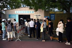 People queue to be tested for Covid-19 at a hospital in Beijing, on Aug 2, 2021.