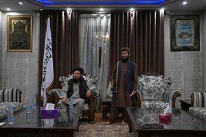 Qari Salahuddin Ayoubi (left), one of the military commanders of the Taliban, inside the home of warlord Abdul Rashid Dostum in Kabul on Sept 11, 2021.