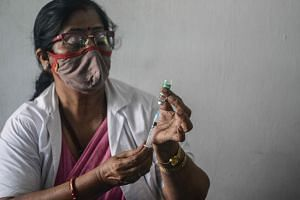 Health officials say though they are studying the evolving science on booster doses, the priority is to fully immunise India's 944 million adults.