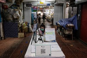 Covid-19 safety notices at the entrance to a market in Chiang Mai, Thailand, on Sept 9, 2021.