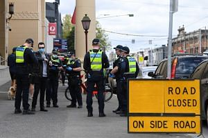Australian police officers setting up checkpoints ahead of planned anti-lockdown protests in Melbourne, on Sept 18, 2021.