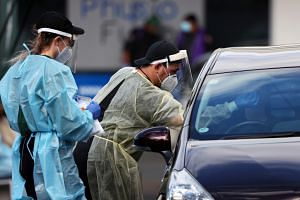 A medical worker administers a COVID-19 test during a lockdown in Auckland on Aug 26, 2021.