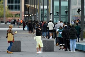 People waiting in line at the Melbourne Museum Covid-19 vaccination clinic, on Sept 17, 2021.