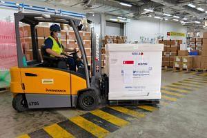 AstraZeneca vaccines being prepared for shipment to Batam, on Sept 28, 2021.