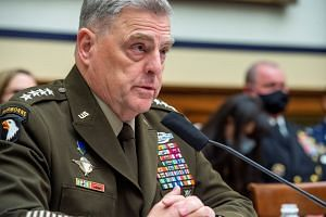 General Mark Milley responds to questions during a House Armed Services Committee hearing on the war in Afghanistan on Sept 29, 2021, in Washington.