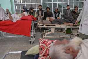 People wait at a corridor for medical treatment at a hospital in Kandahar, Afghanistan, on Oct 4, 2021.