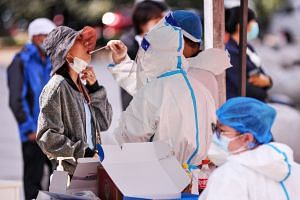 People are tested for the coronavirus in Harbin, China, on Sept 24, 2021.