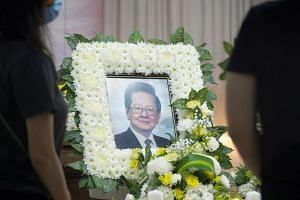 """Mr Cheng (pictured above, at his wake) was waiting for """"version 2.0 of the vaccine"""", said son Melvin Cheng."""
