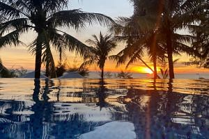A sunset is seen in a resort in Phu Quoc island in Vietnam on May 8, 2020.