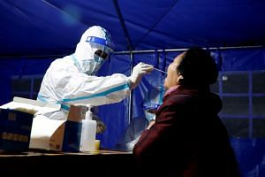 A resident undergoing a Covid-19 test in Zhangye, Gansu, on Oct 21, 2021. New local cases were reported in the province.