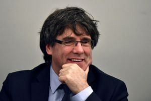 Former Catalan leader Carles Puigdemont takes part in a meeting with his party in Brussels, Belgium on March 14, 2018.