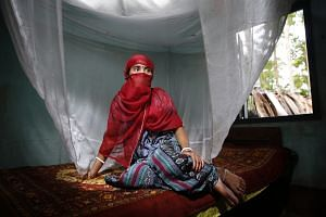 An ex-victim of bride trafficking in Haryana, now remarried and residing in a village in West Bengal, India.