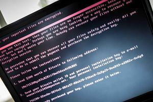A laptop screen displays a message after it was infected with ransomware during a worldwide cyberattack, in Geldrop, Netherlands, on June 27, 2017.