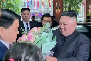 Kim Jong Un makes a splash in Vietnam as Trump lands