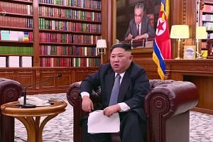 North Korea's Kim says ready to meet Trump but warns of 'new path'