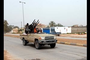 East Libyan troops close on Tripoli, clashes near former airport