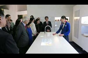 S'pore President Tony Tan gets demonstration of Panasonic smart kitchen